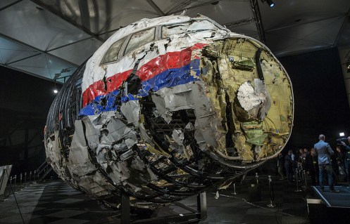 The reconstructed wreckage of the MH17 airplane is seen after the presentation of the final report into the crash of July 2014 of Malaysia Airlines flight MH17 over Ukraine, in Gilze Rijen, the Netherlands, October 13, 2015. Malaysian Airlines Flight 17 was shot down over eastern Ukraine by a Russian-made Buk missile, the Dutch Safety Board said on Tuesday in its final report on the July 2014 crash that killed all 298 aboard. The long-awaited findings of the board, which was not empowered to address questions of responsibility, did not specify who launched the missile. REUTERS/Michael Kooren TPX IMAGES OF THE DAY - RTS48LV